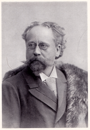 black and white photograph, half-length portrait of Gustav Kogel, facing left.